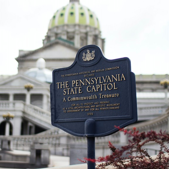 Pennsylvania State Capitol signage with capitol building in background